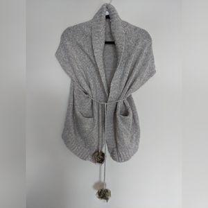 Vero Moda oversized vest with pompom tie.